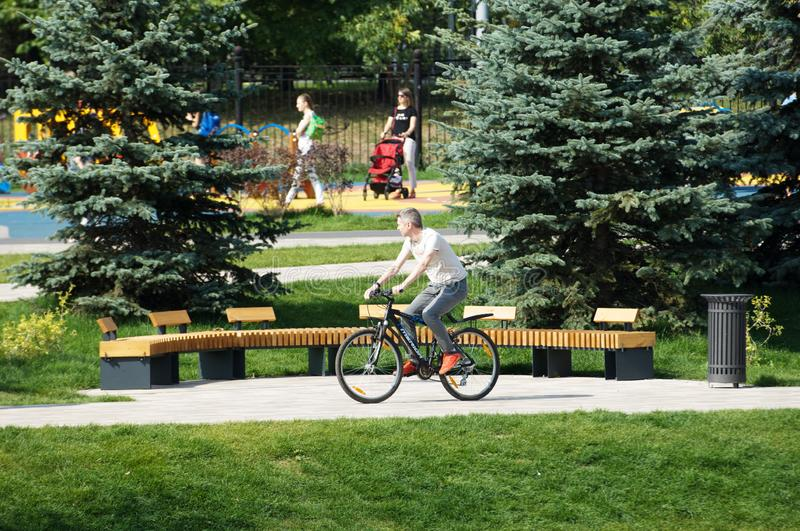 Man ride bicycle in Butovo park, Moscow, Russia stock image