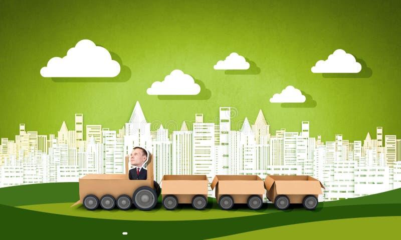 Man ride paper train. Funny cartoon image of businessman riding carton box stock photos