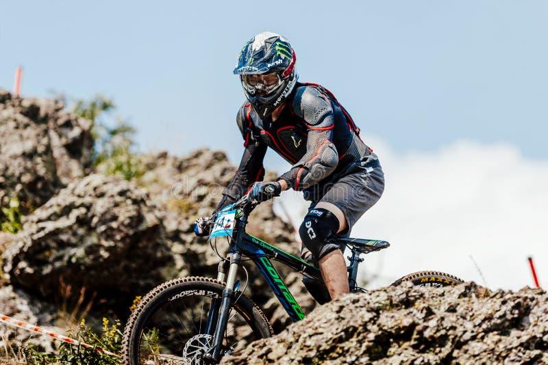 man rider on bike downhill among stones royalty free stock image
