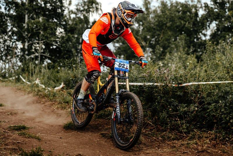 Man rider on bike mountain biking earthen trail royalty free stock images