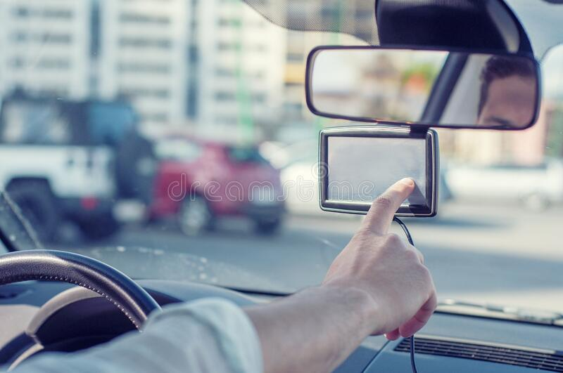 Man rides and uses the gps navigation system In car . Man hand touching to screen multimedia system. Auto stock photos