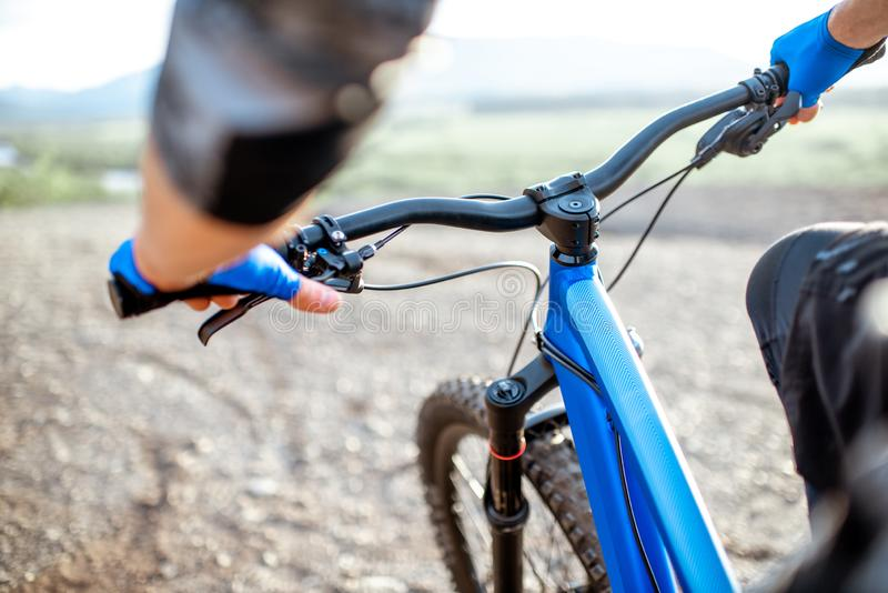 Man riding bicycle, close-up royalty free stock photography