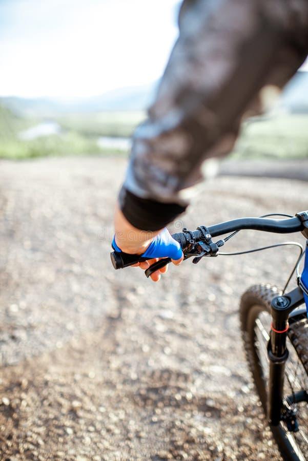 Man riding bicycle, close-up stock images