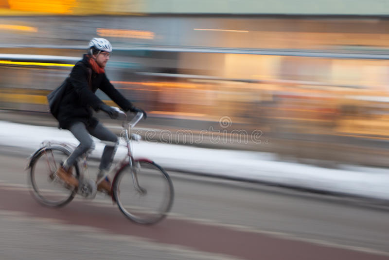 Man riding Bicycle, Stockholm royalty free stock image