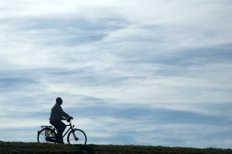 Man riding a bike stock image