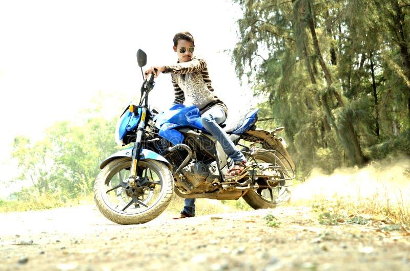 Man Riding Blue Sports Bike stock photography