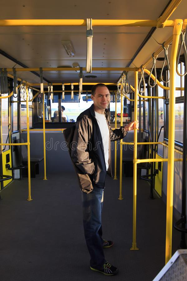 Man is riding a bus on the airfield to plane in the early morning stock photos
