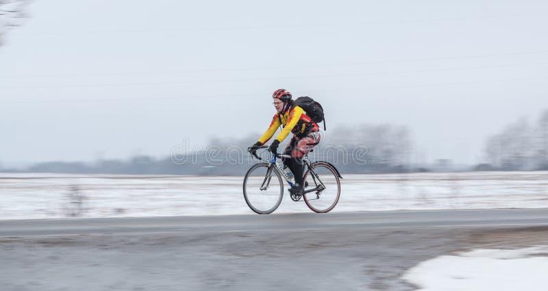 Man riding his bike. Panning. Klimovsk, Moscow Region, Russia - April 4th, 2015: Moscow cycling club Caravan event - 200km brevet(randonneuring, audax). Man stock photos
