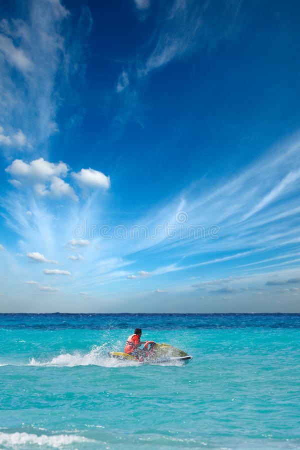 Free Man Riding Jet Ski Royalty Free Stock Photos - 14011418
