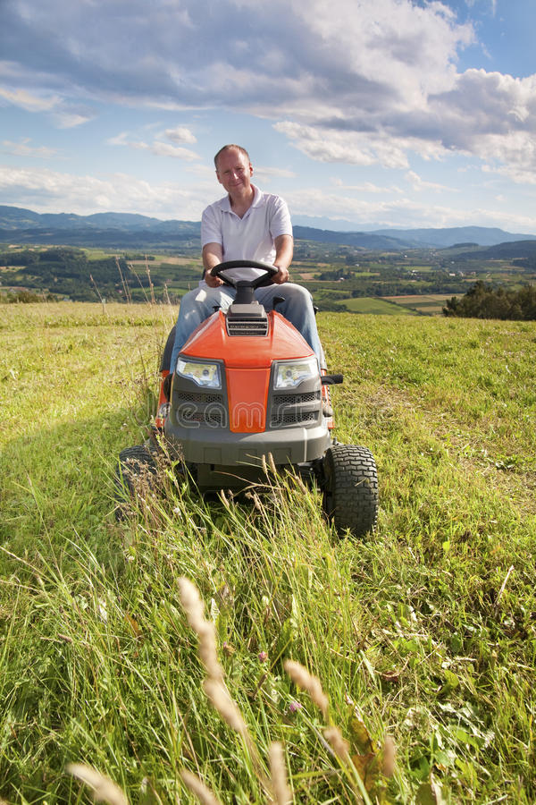 Man Riding A Lawn Tractor Stock Image Image Of Front