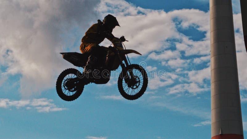 Man Riding Motocross Dirt Bike stock images