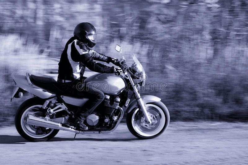 Man riding a motorcycle on the road