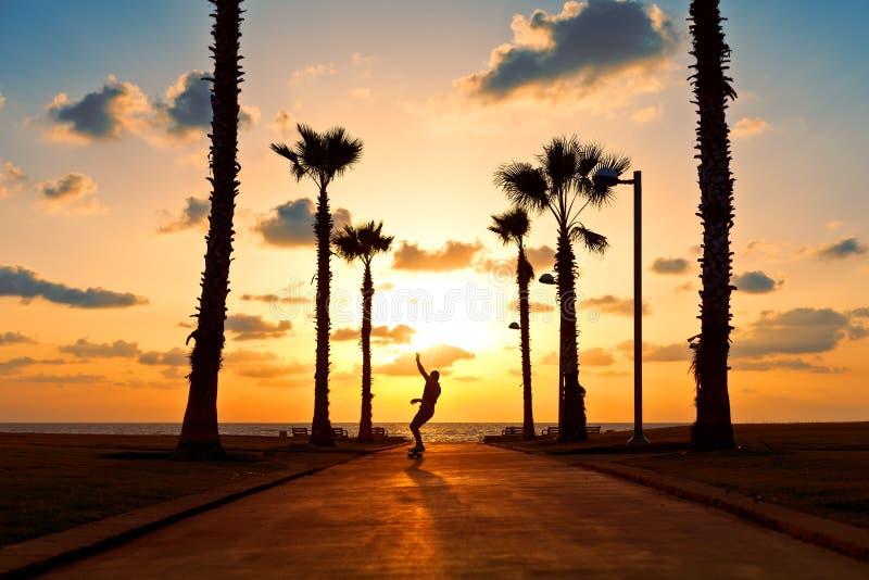 Man riding on skateboard near the ocean royalty free stock image