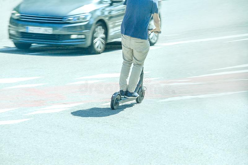 Man riding the streets on electric scooters. Dangerous riding on scooters on the roadway stock photos