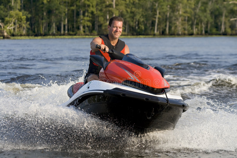 Man Riding Wave Runner In River Royalty Free Stock Image