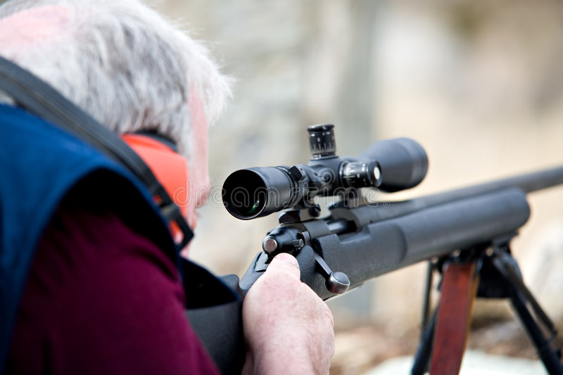 Man with rifle royalty free stock photography