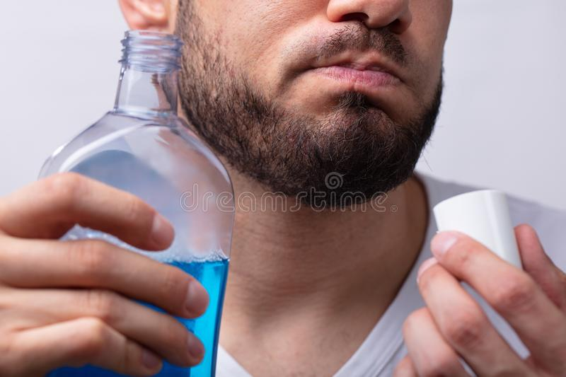 Man Rinsing His Mouth With Mouthwash stock photos