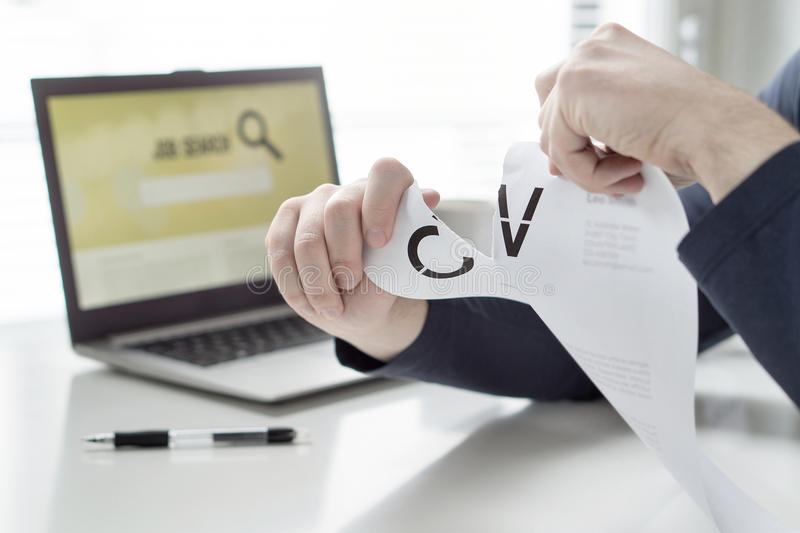 Man ripping his CV and curriculum vitae. Person having problems finding work or writing his job application paper. Angry, frustrated and tired job seeker royalty free stock photos