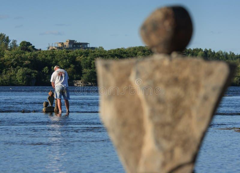 Download Man In River Balancing Stones Editorial Stock Photo - Image: 26597223