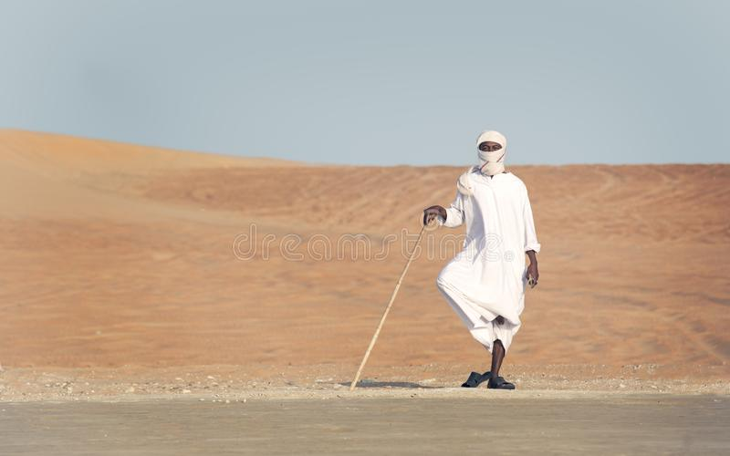 Man on the roadside in a desert royalty free stock photography