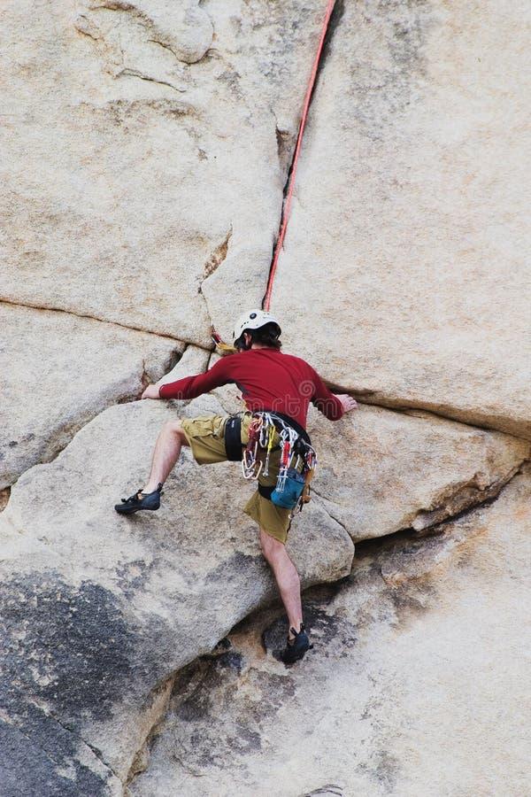 Man rock climbing royalty free stock photography