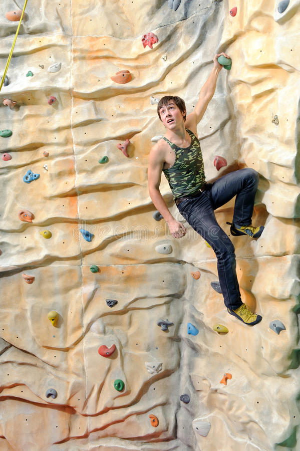 Download Man on rock wall stock image. Image of indoor, concept - 23766277
