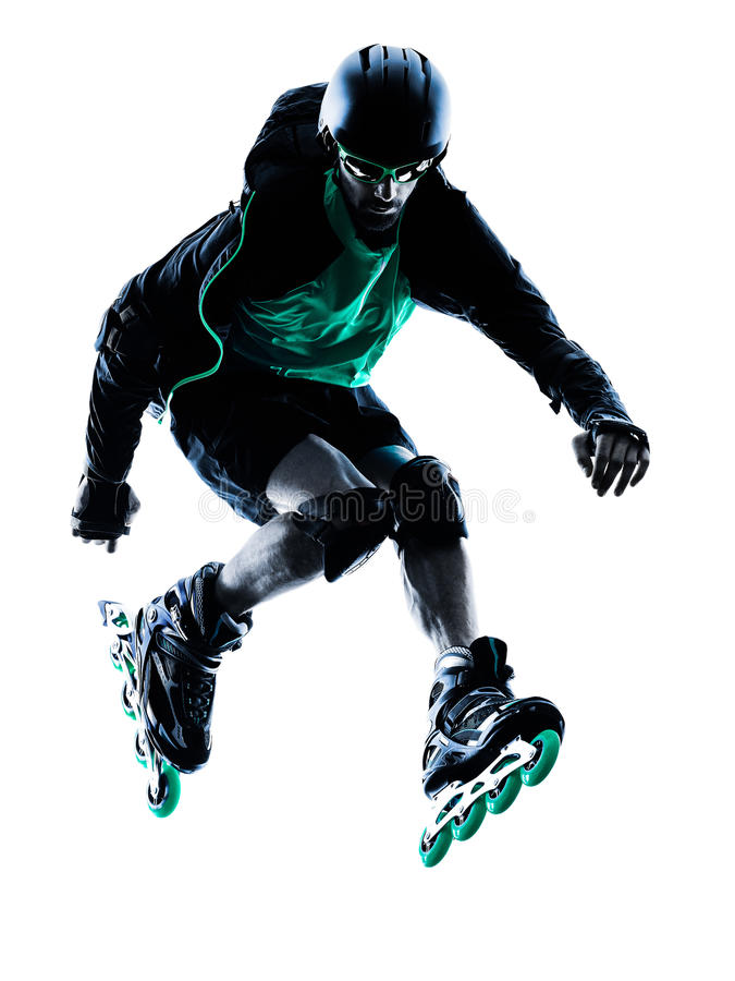 Man Roller Skater inline Roller Blading. One caucasian man Roller Skater inline Roller Blading in silhouette isolated on white background stock photography