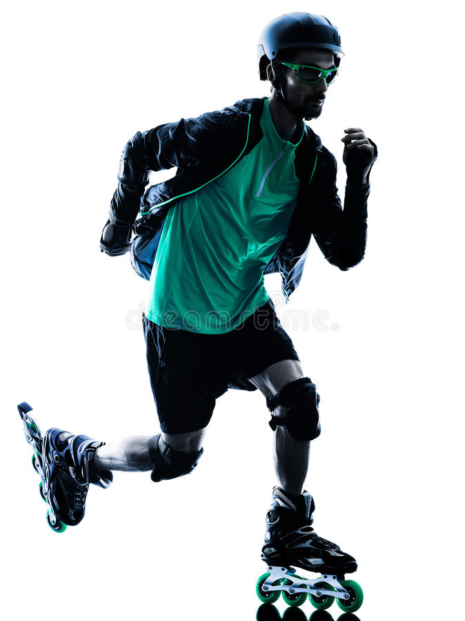 Man Roller Skater inline Roller Blading. One caucasian man Roller Skater inline Roller Blading in silhouette isolated on white background stock image