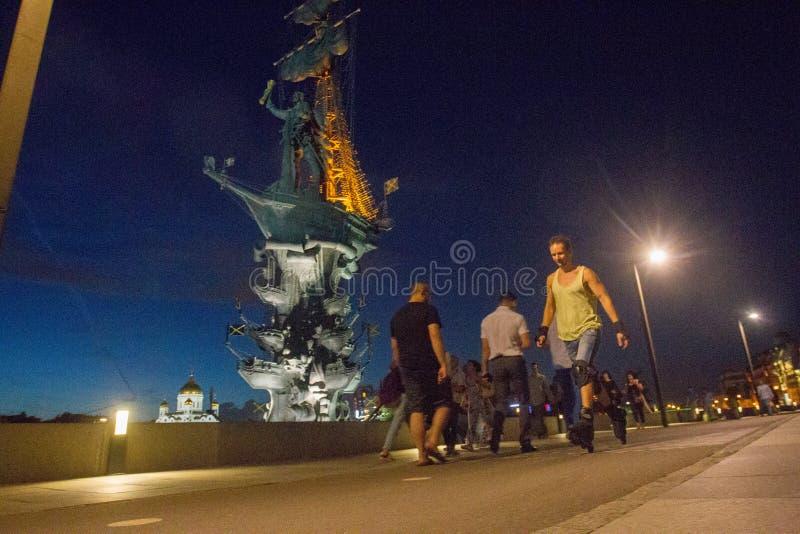 Man  rollerblading at night royalty free stock image