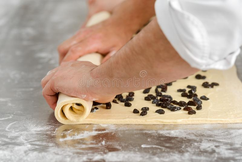 Man is rolling dough stock images