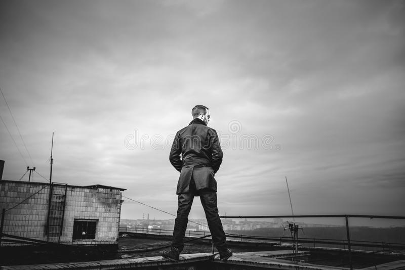 Man on the roof of the high building royalty free stock photo