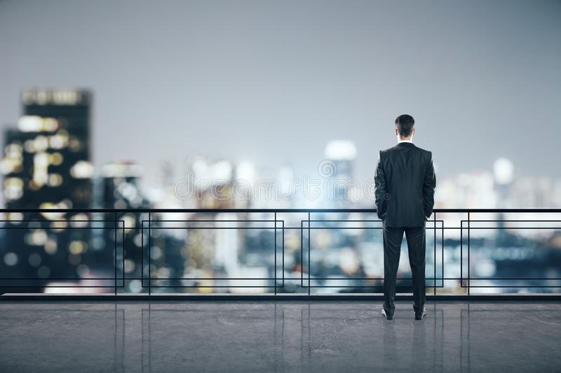 Man on rooftop. Businessman standing on roofrop with panoramic New York city view and copy space. Job and occupation concept stock image