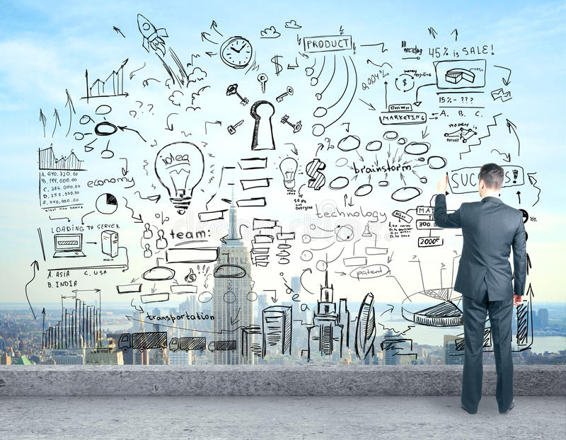 Man on rooftop drawing sketch. Back view of young man drawing abstract business sketch while standing on concrete rooftop. Success concept royalty free stock photos