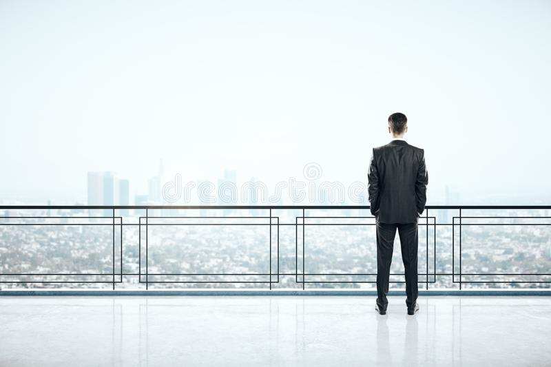 Man on rooftop. Man standing on roofrop with panoramic New York city view and copy space. Job and occupation concept royalty free stock photo