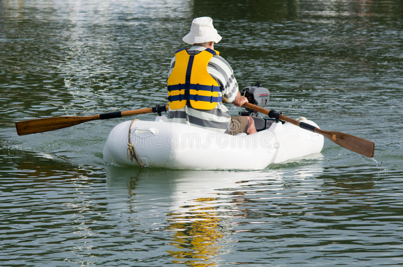 Man rows dinghy boat royalty free stock photography for Four man rubber life craft