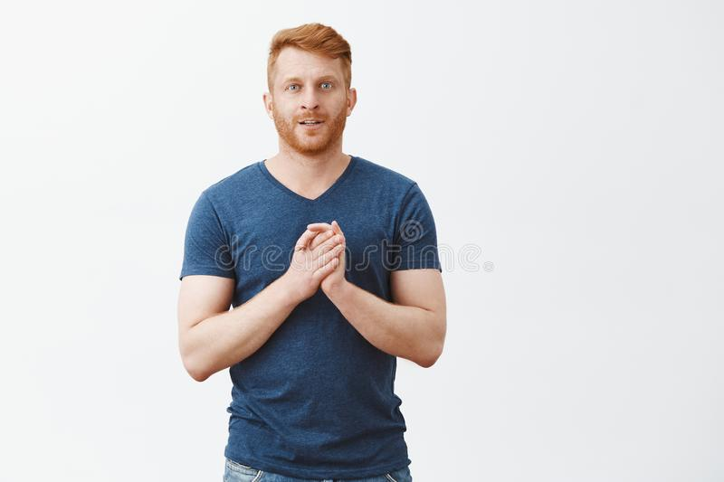 Man rubbing hands, feeling great deal comming. Portrait of excited and intrigued good-looking businessman with ginger royalty free stock image