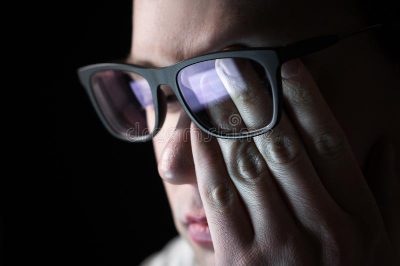 Man rubbing tired eyes. Problem with glasses, eyesight or vision. Person having stress or depression. Workplace bullying. Working late with computer royalty free stock photos