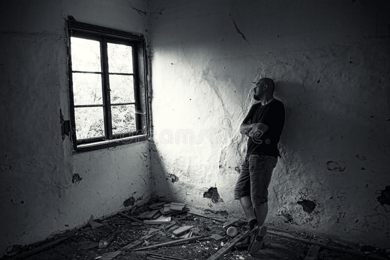 Man in ruined house stock image