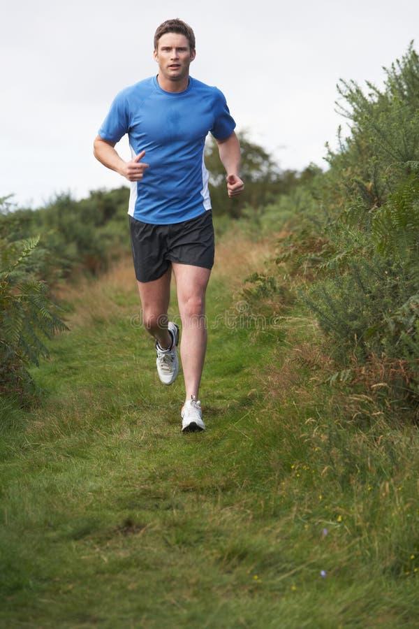 Man On Run In Countryside. Running Towards Camera stock image