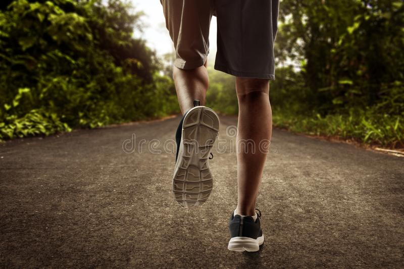 Man running outdoor at day. Man run outdoor at day stock image