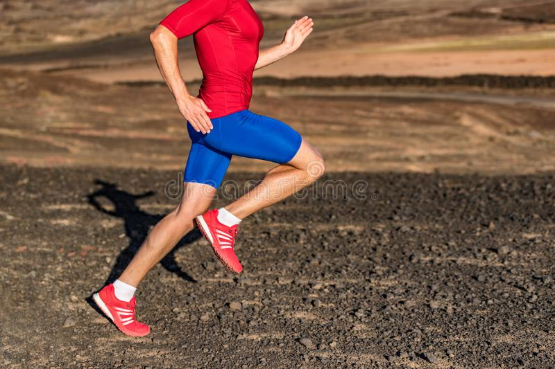 Man runner athlete running on trail run path in mountains. Legs and running shoes in motion on rocky terrain. Knee, hip, thigh,. Foot concept. Healthy active stock images