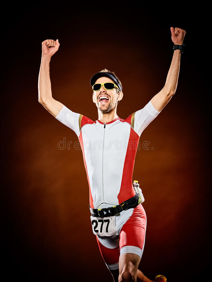 Man runner running triathlon ironman isolated. One caucasian man runner running triathlon ironman isolated stock images