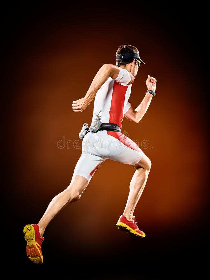 Man runner running triathlon ironman isolated. One caucasian man runner running triathlon ironman isolated stock photography