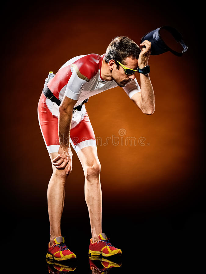 Man runner running triathlon ironman isolated. One caucasian man runner running triathlon ironman isolated royalty free stock photo
