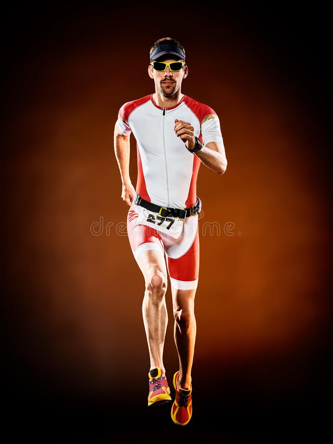 Man runner running triathlon ironman isolated. One caucasian man runner running triathlon ironman isolated stock image