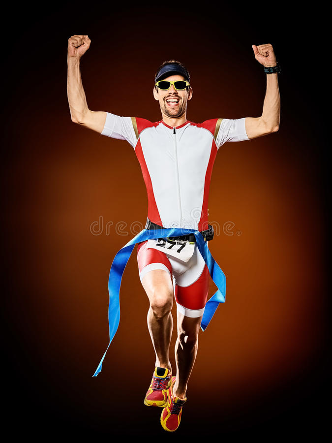 Man runner running triathlon ironman isolated. One caucasian man runner running triathlon ironman isolated royalty free stock photography