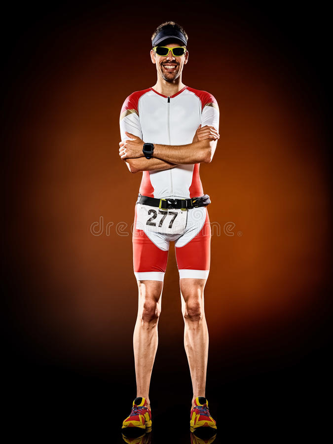 Man runner running triathlon ironman isolated. One caucasian man runner running triathlon ironman isolated royalty free stock image