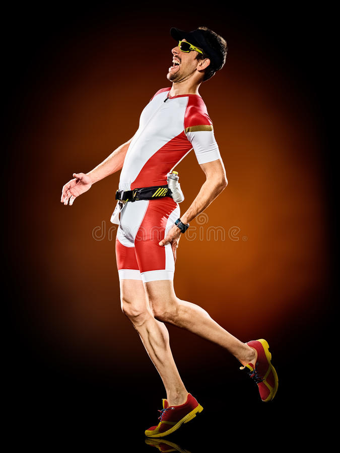 Man runner running triathlon ironman. One caucasian man runner running triathlon ironman stock photos