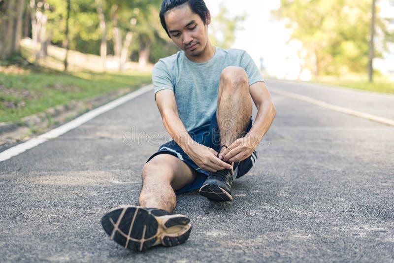 Man runner tying shoelace, ready to run. Man runner tying shoelace, ready to run stock images