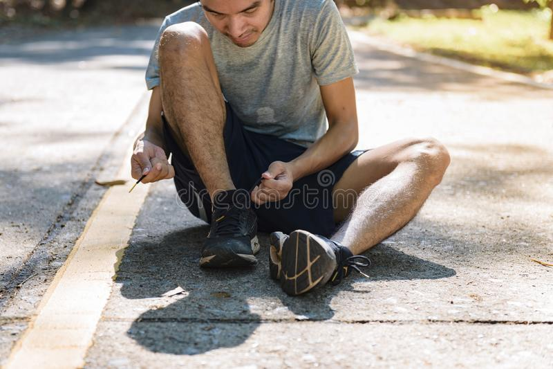 Man runner tying shoelace, ready to run.  royalty free stock photo